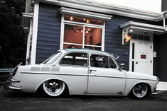Volkswagen Type 3 Notchback... oh, and the house color and awning above door! And the molding above windows. All kinds of ideas/similarities :)