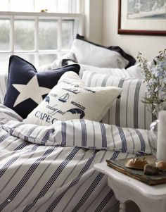 Nicole, for your beach room, I like the white pillow with the navy blue print