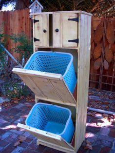 I would do three tiers for standard baskets, and probably openings in the doors to allow for putting clothes in without opening it. (Otherwise it would sit open all the time OR not get used.)
