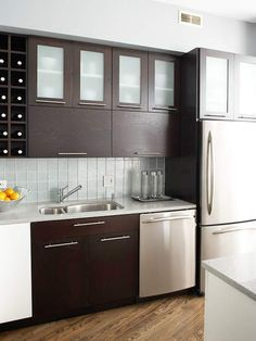 Preserving the existing L-shape layout provided more budget to bring the kitchen's style up-to-date, as well as add efficient storage, such as a wine rack and larger island.