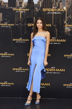 Zendaya dropped by a Spider Man Homecoming photocall in a fun and flirty slip dress by Jonathan Simkhai. The asymmetric silhouette felt like a modern interpretation of the lingerie look, and twin slashes at the front and side gave a neat sense of movement. Zendaya struck a demure pose with one ankle strategically crossed over the other, calling attention to her sequined Rihanna x Manolo Blahnik shoes, instead of a single bared leg—elegant and elevated, in one easy step.