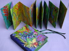 In a Caribbean Garden by Inga Hunter -- Boxed accordion book, paper, collage and paint, double-sided with a pink base on one side and a green-yellow base on the other.