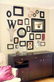 I really want to do something like this but with more pictures on a huge blank wall in in my hall/ foyer area.