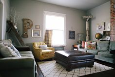 Muted, relaxed family living room w/ vintage yellow chair