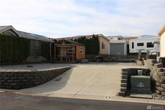 Improved Lake Chelan view lot at gated Vista Del Lago is ready for your RV or Park Model Home!  Enjoy an active lifestyle at this 55+ community with walking access to parks, wineries, restaurants, and the Manson marina.  Relax and have fun at the resort's outdoor heated pool & clubhouse.  Laundry and boat storage areas available.  Lot features spacious east view, paid hookups, and storage building with finished interior.  All interior/exterior furnishings included. Boat Storage, Built In Storage, Park Model Homes, Vacant Land, Heated Pool, Wineries, Interior And Exterior, Parks, Rv