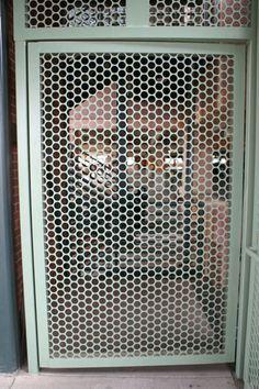 big perforated metal door