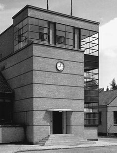 Fagus Factory, Alfeld, Germany | Architect: Eduard Werner | Facade Design:  Walter Gropius and Adolf Meyer. The small isolated clock on the front has adds an incredible amount to the overall esthetic of the building facade.