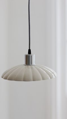 Crafted in beautifully shaped ceramic, our Lyon Pendant Light brings a touch of vintage charm to any living space.