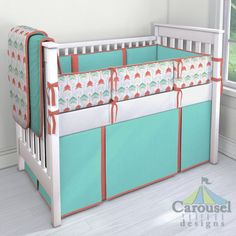 Crib bedding in Solid Teal, Coral and Teal Arrows, Solid Coral, Solid White. Created using the Nursery Designer® by Carousel Designs where you mix and match from hundreds of fabrics to create your own unique baby bedding. #carouseldesigns