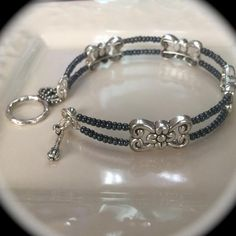 All jewelry is handcrafted with glass beads and silver plated accents. - Bracelets are made with a memory wire material and easy clasp closure, so it will fit all wrist sizes comfortably.