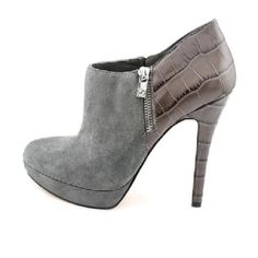 Michael kor boots Gray Leather/ suede platform with zipper on sides... Brand new never walked in them Michael Kors Shoes Ankle Boots & Booties
