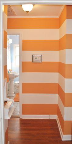 Sherbet colored stripes enliven a hallway