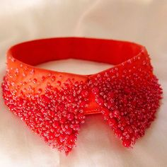 A newly finished coral red 'berry' collar catches the winter sunlight flooding through the studio's windows on this beautiful Sunday... #detacablecollars   subtle #bling #handembroidered #designer #fashion #accessories #tambour #beading #glass #beads #lesage #red #berry #collar #design #handembroidery #embroidery #madebyhand #krave #håndbroderet #perlekrave #mode #broderi