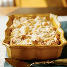 Butternut squash and Parm bread pudding. We're always on the lookout for vegetarian casseroles to bring to ppl's houses that won't freak them out.