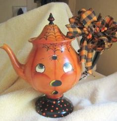Friendly pup face teapot with polka dots. Whimsy Halloween. Love how eyes look up at spider coming down from web.
