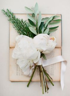 Large white peonies with rosemary and sage