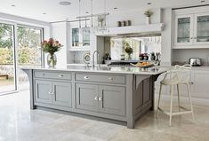 this contemporary grey kitchen is packed with appliances and features that are b… - luxury kitchen Open Plan Kitchen Living Room, Kitchen Dining Living, Home Decor Kitchen, Kitchen Interior, New Kitchen, Space Kitchen, Family Kitchen, Cheap Kitchen, Grey Kitchens