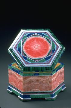 Intarsia Box - This elegant box (diameter 14cm or 5.5in) was created and designed by Nikoli Medvedev and is an outstanding example of intarsia, or stone inlay. Among the minerals represented in the box are rhodochrosite (pink), malachite (green), azurite (blue), sugilite (purple), and opal (white).