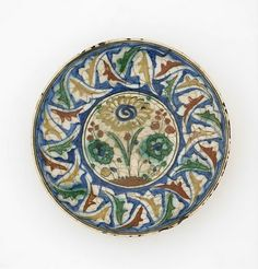 Plate | Origin: Iran | Period: late 16th-early 17th century Safavid period | Details: Not Available | Type: Stone-paste painted under colorless glaze | Size: W: 8.4 cm | Museum Code: S1997.56 | Photograph and description taken from Freer and the Sackler (Smithsonian) Museums.