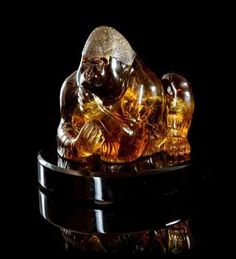 An Important Illuminated Citrine Gorilla Carving, Manfred Wild, Idar-Oberstein, Germany, an exceedingly rare naturally colored citrine