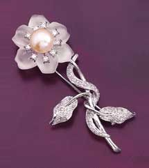 Professional Jeweler Archive: Pearls of Wisdom/18k gold flower brooch is centered with a white cultured pearl and has 0.53 carat of diamonds on its leaves, stems and petals. Suggested retail, $1,430.