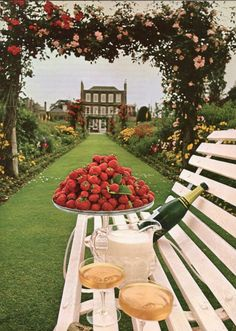 When summer is coming in, the gardens of England burgeon with seasonal delights. Among these delights are strawberries just off the vine, served with rich cream and a freshner of champagne, like these displayed on the grounds of Petersham House, a Georgian architectural masterpiece in Surrey.