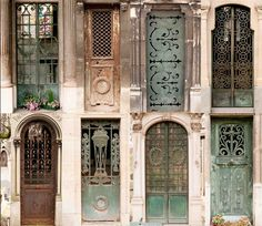 Doors to family crypts, Montmartre by Susan Elliott