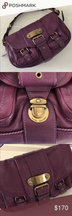 Marc Jacobs Plum Leather Shoulder Bag Yummy plum leather Marc Jacobs handbag with gold metal details. 2 large exterior pockets with buckle detail. Shoulder straps with gold metal details. Leather flap with metal buckle, opens up to inside with tan Marc Jacobs interior fabric, with supper pouch and pockets. This bag feels heavier due to the leather and metal details. Gently used, with slight wear on flap buckle. Purchased brand new from Nordstrom and well-cared for, stored handbag bag for…