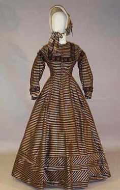 Day dress circa 1860's Probably post 1865 - the skirts are narrow, and the square trim is trendy by then - but noticed the bias bands of material on the skirt. What a great effect!]