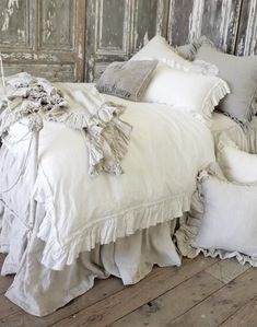Romantic country simple linen bedroom comforter ideas with one ruffled edge.
