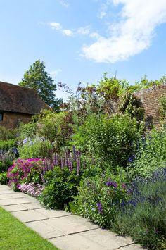 Walled English herbaceous garden border - great use of height at the back