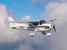 A flight training airplane on a flying lesson mission over NYC, USA - Farmingdale