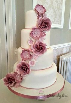 Dusky Pink Vintage Wedding cake with cascade of roses and blossoms.  Wedding Trends 2015 2016