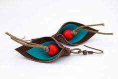 Handmade upcycled leather leaf dangle earrings by JennijoDesigns