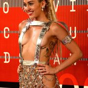 awesome Pictures: Miley Cyrus wears crazy and revealing outfits to host the MTV VMAs