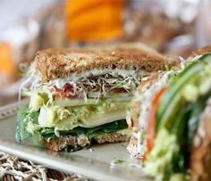 The Ultimate Veggie Sandwich Recipe  ---=-=-=-=-=-=-=-=-=-=-=-=-=-=-- Awesome Recipe By: www.yummly.com  ---=-=-=-=-=-=-=-=-=-=-=-=-=-=-- Ingredients:  --=-=-=-=-=-- 4 slices Dave's Killer Bread Organic Seeded Honey Wheat 1/2 c. spinach 2 slices pepper jack cheese 2 slices Swiss cheese 4 tbsp. mashed avocado mixed w/1 tsp. fresh lemon juice & salt to taste 1/2 cucumber thinly sliced 1 Roma tomato thinly sliced 1 c. alfalfa sprouts 1 tbsp. sunflower seeds  Method…