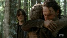 One of the best moments! Rick hugging Carol with Daryl looking on :)