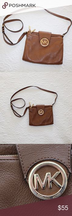 Michael Kors Tan Crossbody Double Zip Purse This tan purse matches every outfit! Good condition, slight tarnishing on the MK logo in front and on zippers. Has 6 spots for cards on inside and multiple pockets. No trades! Open for offers. Michael Kors Bags Crossbody Bags
