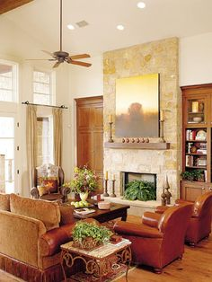 family room with leather chairs and stone fireplace
