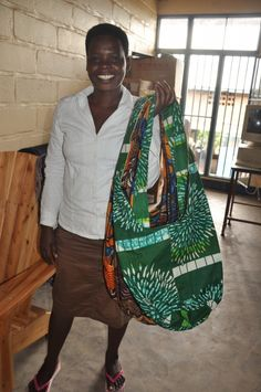 This woman has earned her tailoring degree through a vocational school in Rwanda. Now she can pay her rent, cover her childrens school fees, and provide them with nutrition and basic medical care.