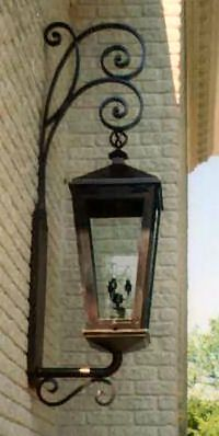 hand forged wall mount lamp available in wrought iron or aluminum
