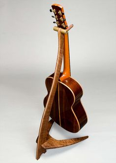 WM Guitar Stand in Claro Walnut with Curly Maple Inlay Guitar Hanger, Guitar Hooks, Wooden Guitar Stand, Guitar Storage, Guitar Online, Better Music, Music Stand, Cool Guitar, Fine Furniture