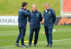 Roy Hodgson talks to Gary Neville and Ray Lewington at St George's Park on Tuesday 27th May 2014.