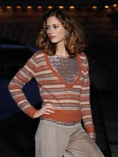 Knit this womens deep v neck stripy sweater from Parisian Nights. A design by Lisa Richardson using the beautiful Kidsilk Haze, a versatile fine yarn made from 70% mohair and 30% silk. This knitting pattern is suitable for intermediate knitters.