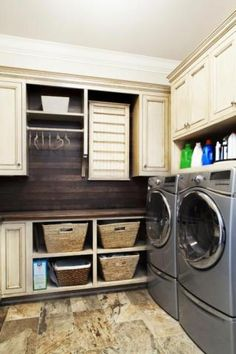 Love the flooring choice and cabinets in this laundry room, but I wouldn't have chosen the stainless washer/dryer...would look better with cream or even blue or red