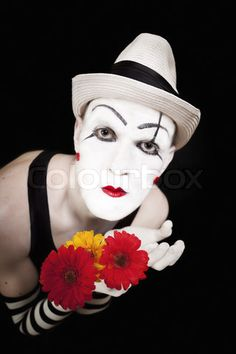 Painted white face of a Mime