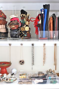 Paper towel holders as belt storage - I love this idea! Using the paper towel holders for belts and magazine holders for purses is so clever. Think I might give this one a go. The towel holders would work for bracelets too.