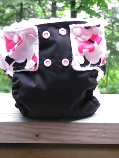 Cloth diaper sewed from black PUL and Cotton from Ann Kelle for RK (pink scotty dogs) lined with pink minky dot and has pink snaps.