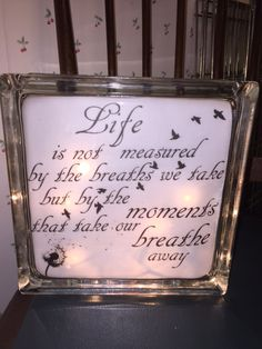 """Life is not measured by the breaths we take but by the moments that take our breath away"" lighted glass block. One of my lighted glass blocks! Check out my store on Etsy called IrwinRags! Diy Christmas Shadow Box, Christmas Signs Wood, Decorative Glass Blocks, Lighted Glass Blocks, Easy Craft Projects, Crafts To Make, Vinyl Projects, Glass Block Crafts, Wood Craft Patterns"