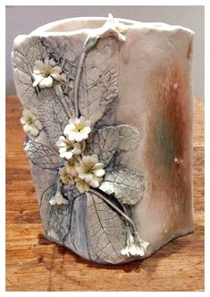 Handcrafted slab vase with Primula flower detail; made from porcelain clay Hand Built Pottery, Slab Pottery, Pottery Vase, Ceramic Pottery, Ceramic Clay, Ceramic Vase, Porcelain Clay, Keramik Design, Pottery Handbuilding